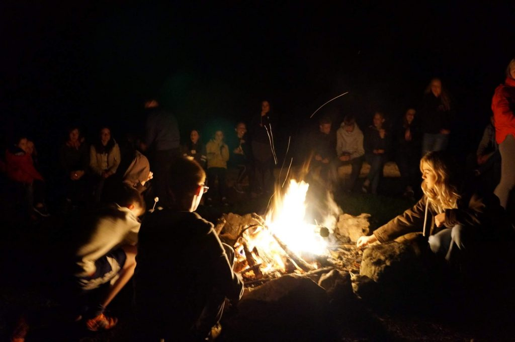 Young people 'round the campfire